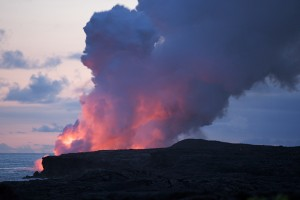 Lava entering the sea after sunset