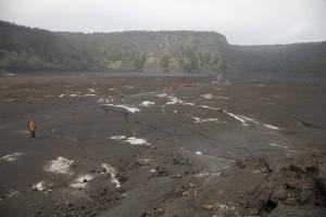 Orange specks crossing the crater floor